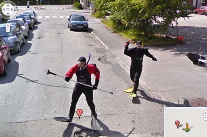 men in diving suits chasing a google car